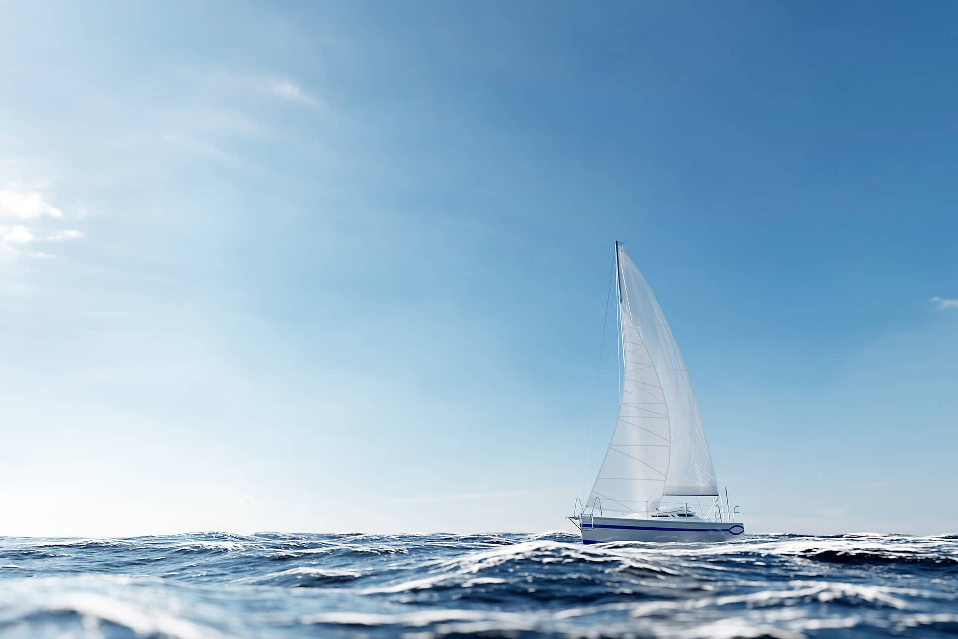 Sailing yacht on the ocean at sunny day